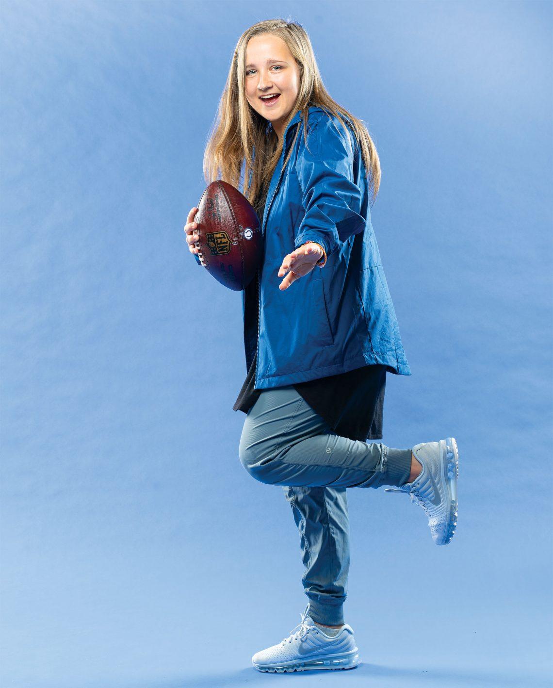 Kasia Omilian holds a football.